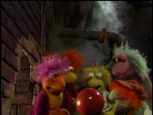 Fraggles gathered around a Round Thing