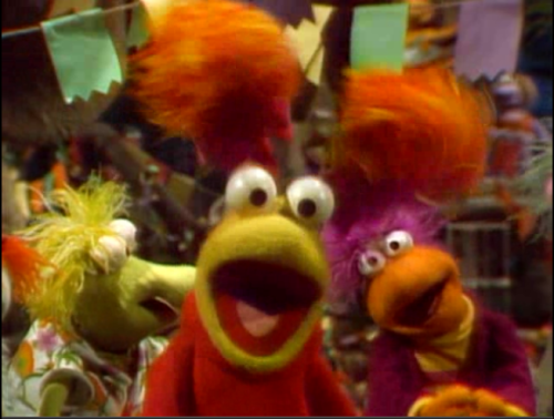 Red Fraggle sings with her friends
